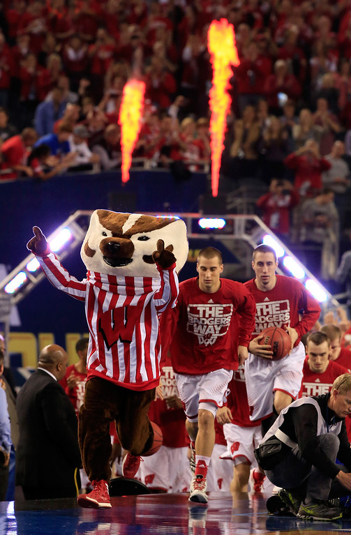 . ARLINGTON, TX - APRIL 05: The Wisconsin Badgers take the floor before the NCAA Men\'s Final Four Semifinal against the Kentucky Wildcats at AT&T Stadium on April 5, 2014 in Arlington, Texas.  (Photo by Jamie Squire/Getty Images)