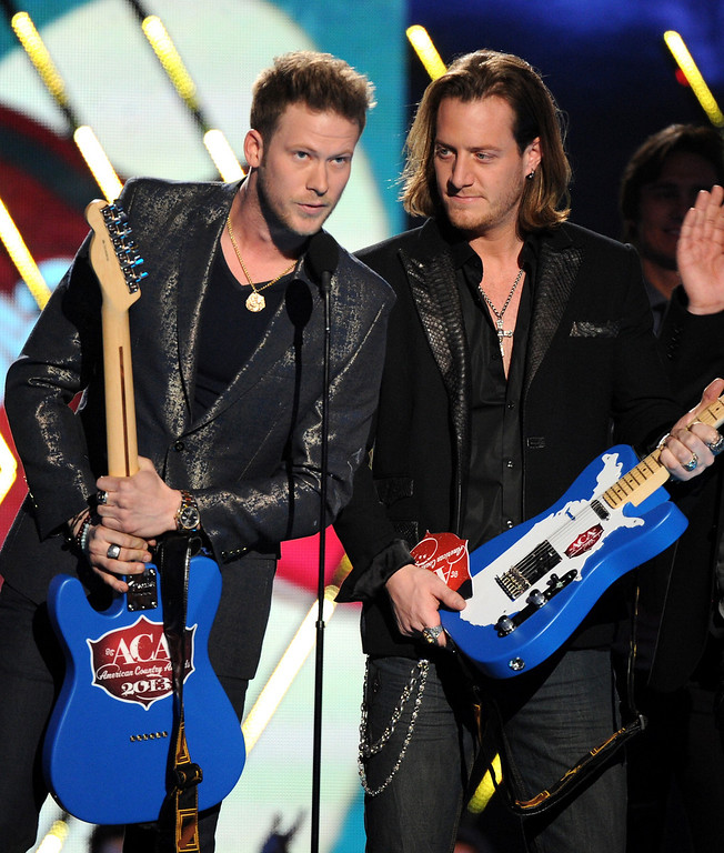 . Brian Kelley, left, and Tyler Hubbard, of musical group Florida Georgia Line, accept the single of the year award for \'Cruise\' at the American Country Awards at the Mandalay Bay Resort & Casino on Tuesday, Dec. 10, 2013, in Las Vegas, Nev. (Photo by Frank Micelotta/Invision/AP)