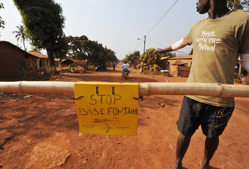 . A man stands as members of the \'\'Centrafrican Young Patriots\'\' block a road to prevent rebels from entering Bangui, on January 1, 2013. The death of a young Muslim man arrested for alleged links to rebels in the Central African Republic sparked clashes on January 1, 2013 in the capital that killed a policeman, a police source said. The unrest erupted as countries in the region sent reinforcements to protect the capital Bangui from rebels who control much of the country and are demanding the departure of President Francois Bozize. SIA KAMBOU/AFP/Getty Images