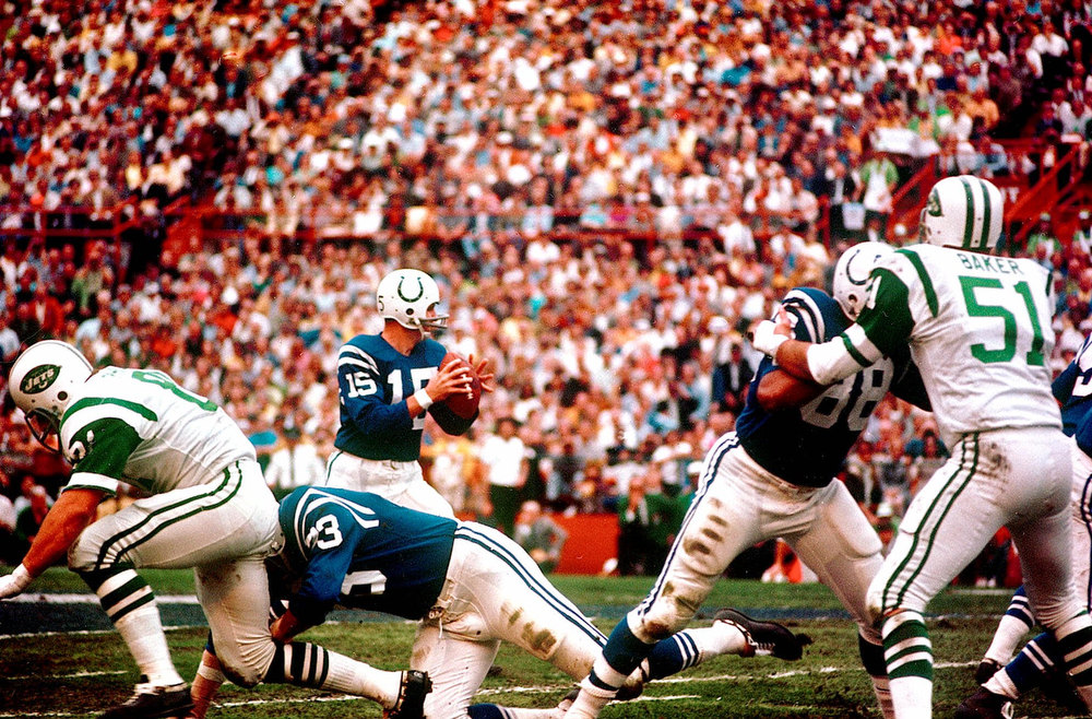 Description of . Baltimore Colts quarterback Earl Morrall (15) looks for a receiver down field during Superbowl III Jan.12,1969  between the Colts and Jets in Miami, Fla. (AP Photo)