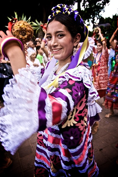 "A street performance of the ""Baile de la Flor de Piña"" in Oaxaca, Mexico."