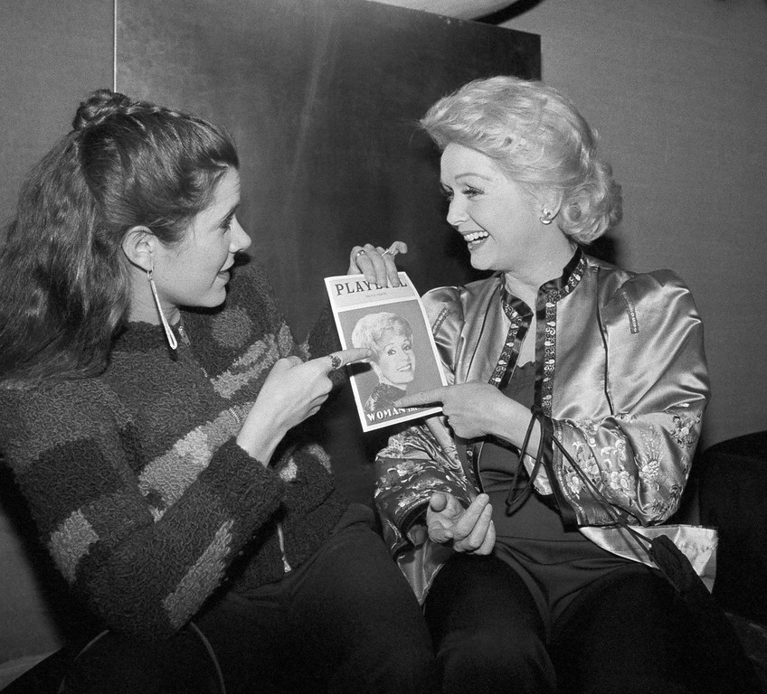 . Debbie Reynolds at a party celebrating her appearance, Feb. 16, 1983 in Broadway play ?The Woman of the Year?, she is with her daughter Carrie Fisher. (AP Photo/Nancy Kaye)