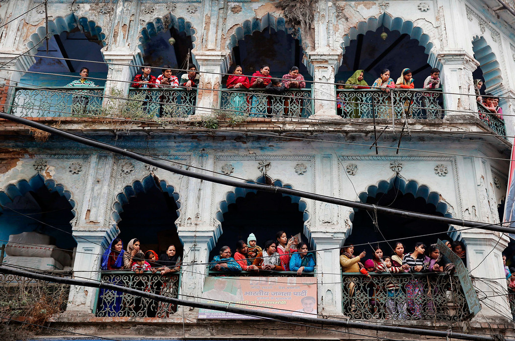 """. Indian people watch a \'Shivratri\' procession in Allahabad, India, Thursday, Feb. 27, 2014. \""""Shivaratri\"""", or the night of Shiva, is dedicated to the worship of Lord Shiva, the Hindu god of death and destruction. (AP Photo/Rajesh Kumar Singh)"""
