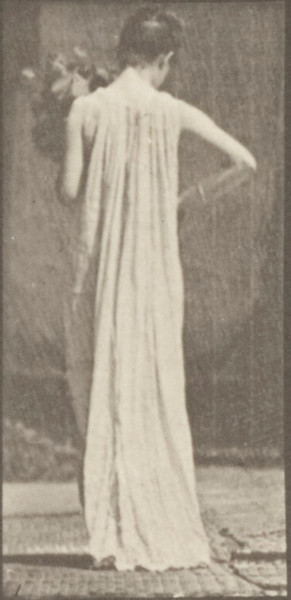 Semi-nude woman carrying and stooping with a vase