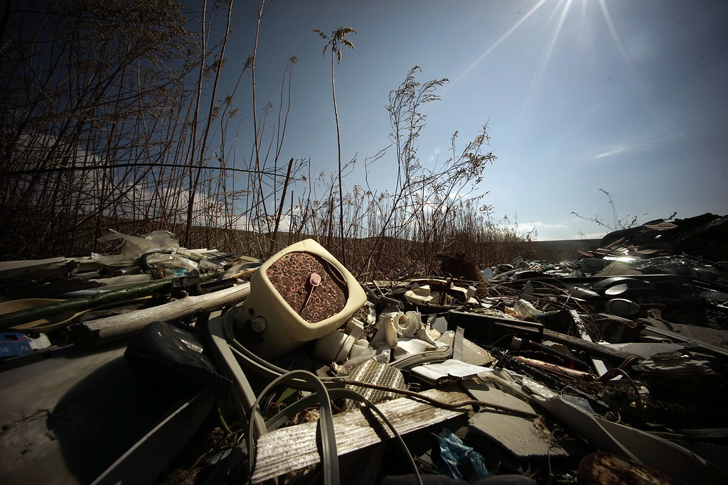 . In this Friday, March 6, 2015 photo, some objects from the March 11, 2011, tsunami remain tossed along the ground in Rikuzentakata, Iwate Prefecture, northeastern Japan. (AP Photo/Eugene Hoshiko)