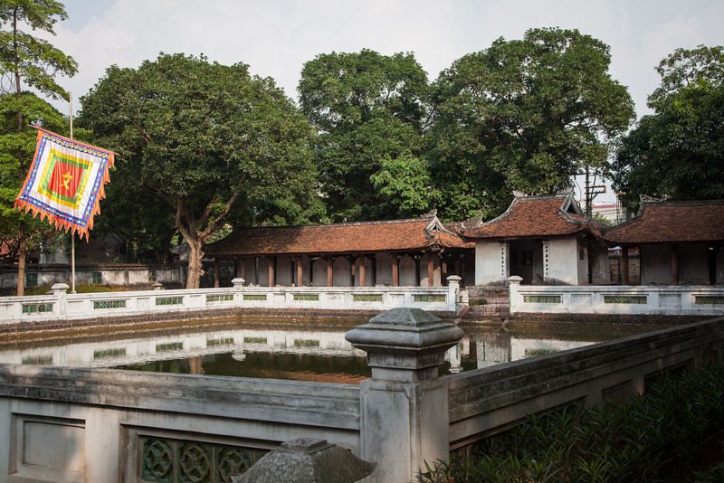 A courtyard inside the Temple of Literature. The stelae from earlier are in the small structures across the water.