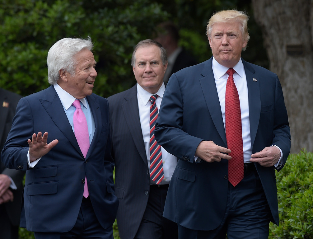 . President Donald Trump talks with New England Patriots owner Robert Kraft, left, followed by head coach Bill Belichick as they arrive for a ceremony on the South Lawn of the White House in Washington, Wednesday, April 19, 2017, where the president honored the Super Bowl Champion New England Patriots for their Super Bowl LI victory. (AP Photo/Susan Walsh)