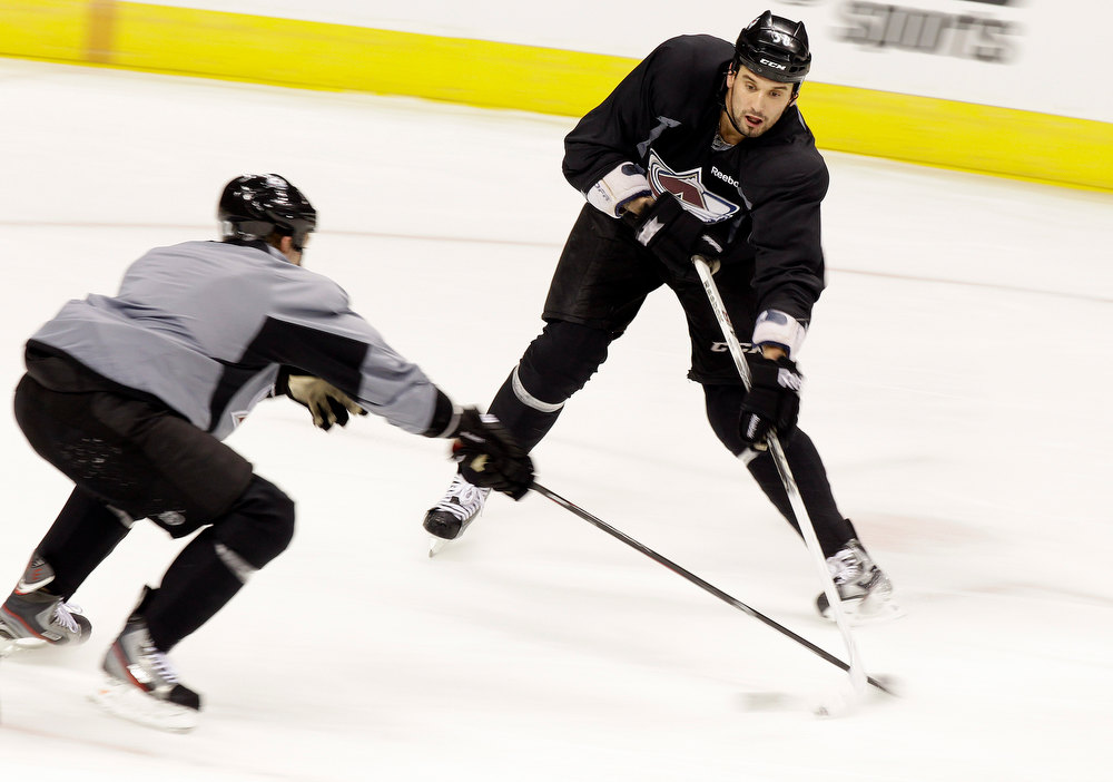 . Colorado Avalanche\'s Patrick Bordeleau, of Canada, right, fights to control the puck during NHL hockey practice, Thursday Jan. 17, 2013, in Denver, Colo. (AP Photo/Brennan Linsley)