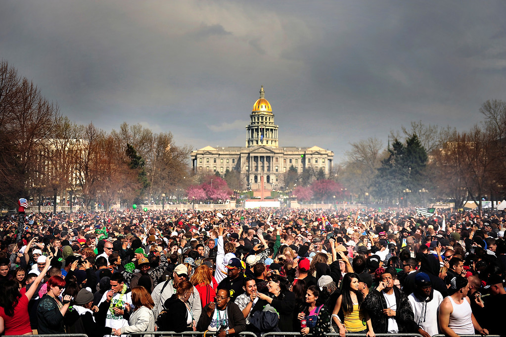 . A cloud of smoke covers the crowd at 4:20 PM at the Annual Denver 420 Rally in Civic Center Park.      Joe Amon, The Denver Post