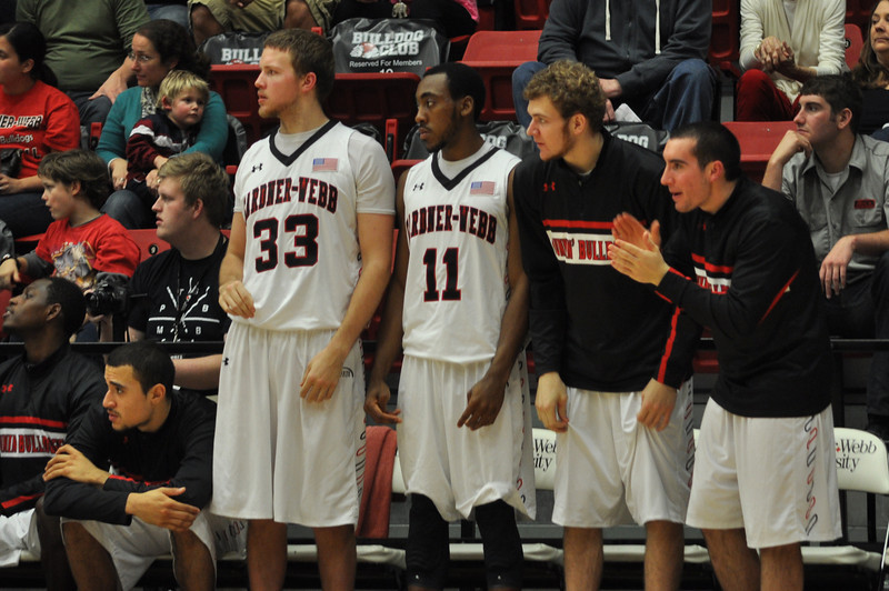GWU bench cheers on their teammates against UNC Asheville