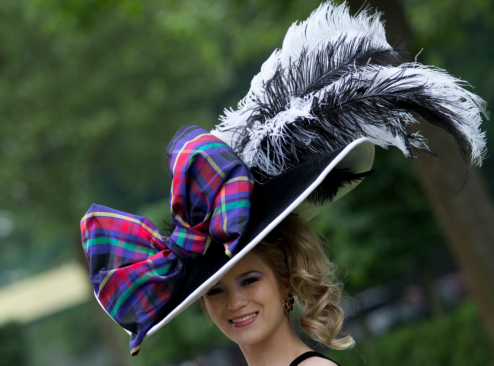 . Mimi Theobald poses for the media with an ornate hat on the third day traditionally known as Ladies Day of the Royal Ascot horse race meeting in Ascot, England, Thursday, June 20, 2013. (AP Photo/Alastair Grant)