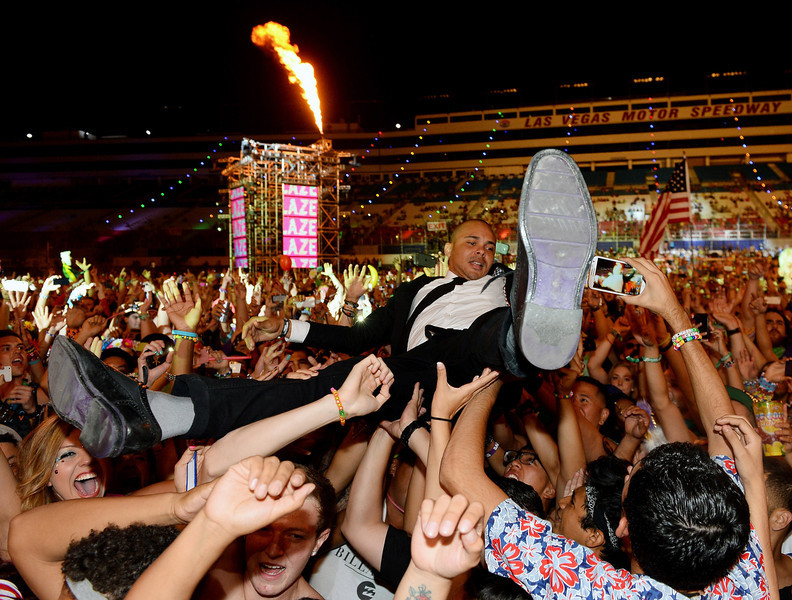 . Walshy Fire of Major Lazer surfs the crowd as he performs at the 17th annual Electric Daisy Carnival at Las Vegas Motor Speedway on June 23, 2013 in Las Vegas, Nevada.  (Photo by Ethan Miller/Getty Images)
