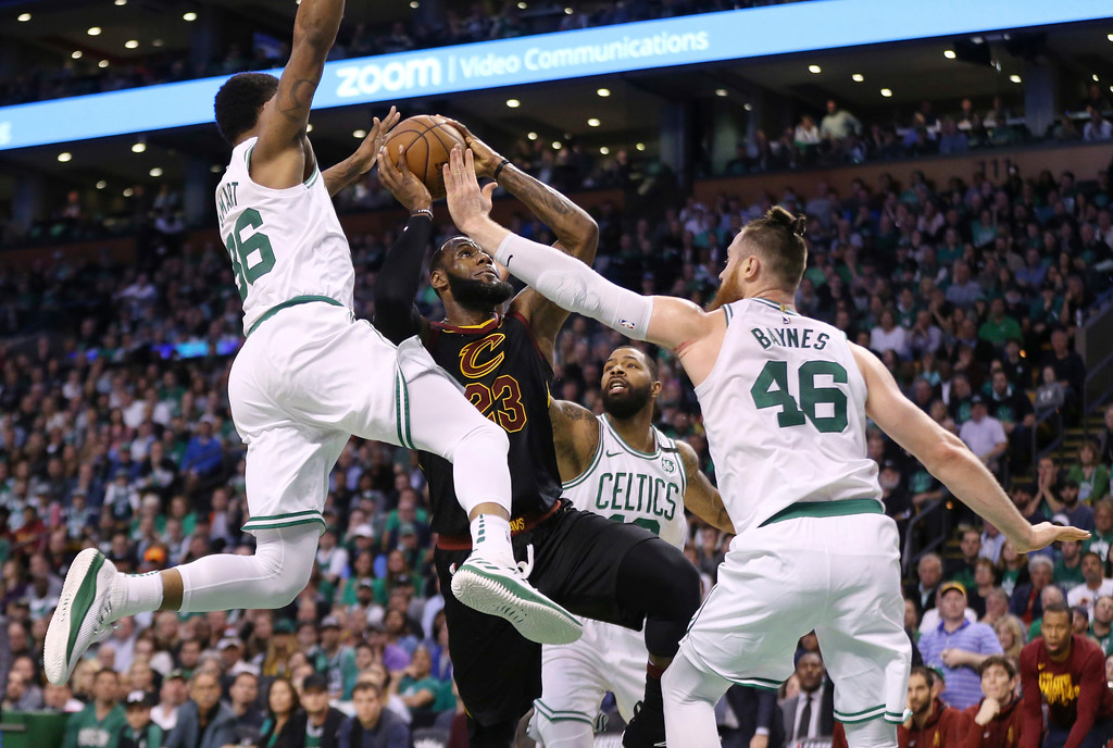 . Cleveland Cavaliers forward LeBron James drives between Boston Celtics guard Marcus Smart (36) and center Aron Baynes (46) during the first half in Game 7 of the NBA basketball Eastern Conference finals, Sunday, May 27, 2018, in Boston. (AP Photo/Elise Amendola)