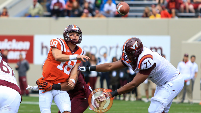 QB Chase Mummau (18)  gets a pass away before he is tackled. (Mark Umansky/TheKeyPlay.com)
