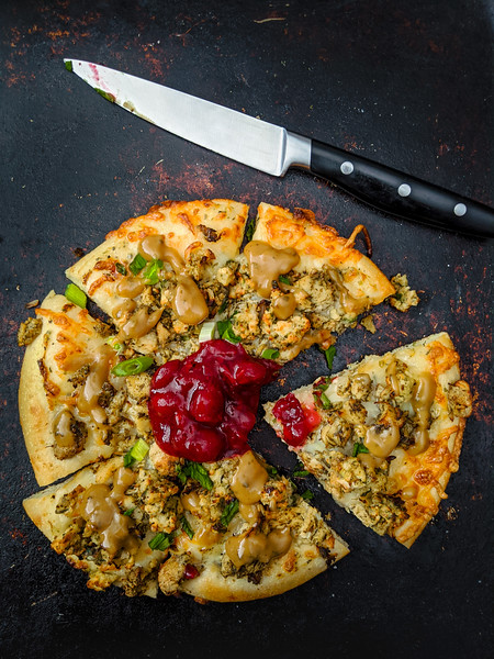 Christmas pizza with gravy with knife.jpg
