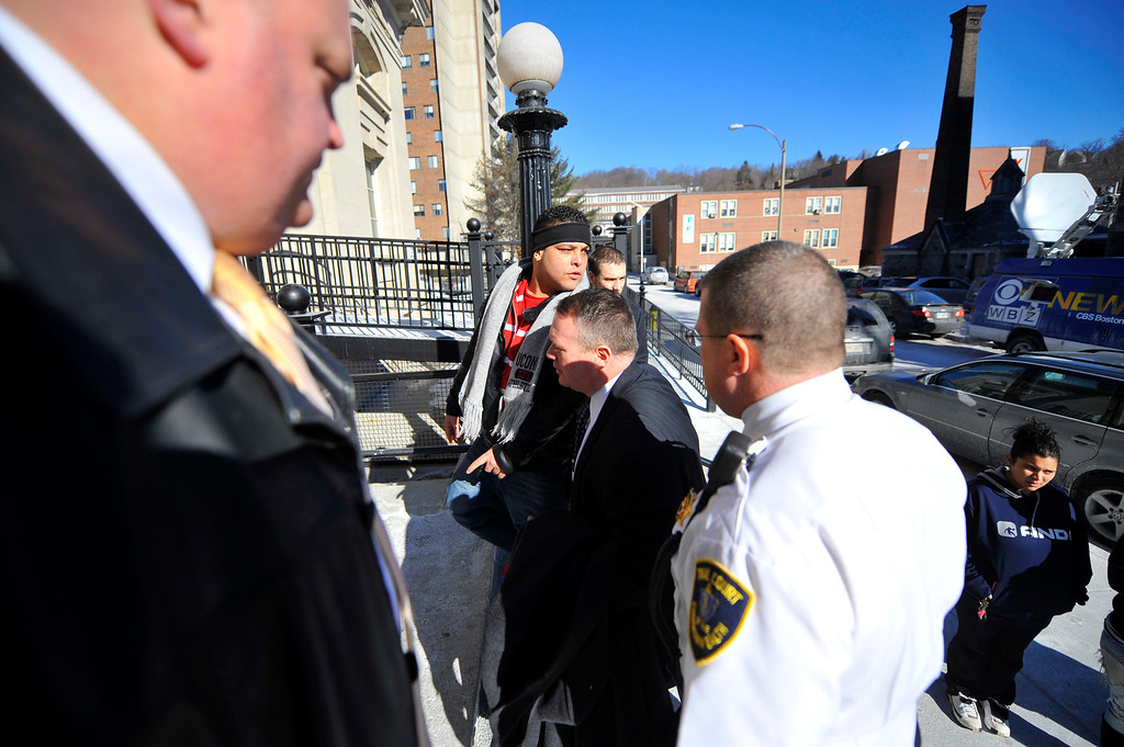 . Jose Oliver (wearing headband), father of missing 5-year-old Jeremiah Oliver of Fitchburg is escorted back into Fitchburg District Court for a verbal outburst after the competency hearing of Elsa Oliver in Fitchburg District Court, Friday. SENTINEL & ENTERPRISE / BRETT CRAWFORD