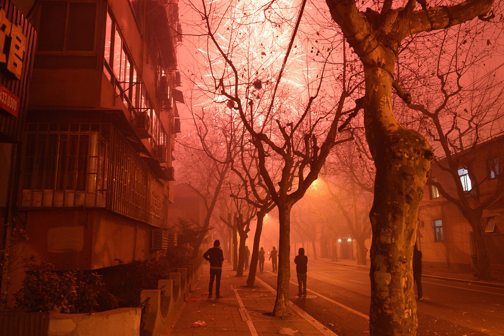 . Fireworks explode in a street of Shanghai on the eve of Chinese New Year on January 30, 2014. China prepares to welcome the Lunar New Year of the Horse which falls on January 31 and will see about 3.62 billion trips made by Chinese travelers during the 40-day Spring Festival travel period.     AFP PHOTO/Peter PARKS/AFP/Getty Images