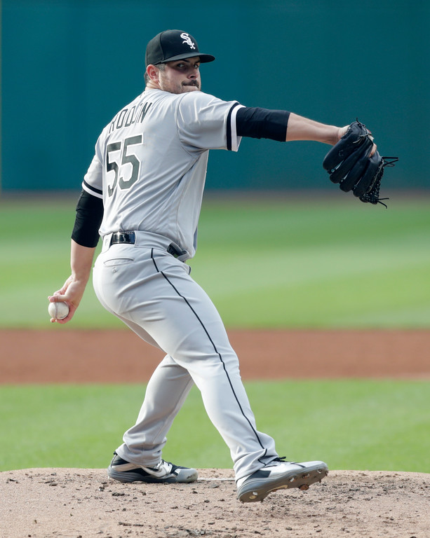 . Chicago White Sox starting pitcher Carlos Rodon delivers in the first inning of a baseball game against the Cleveland Indians, Tuesday, June 19, 2018, in Cleveland. (AP Photo/Tony Dejak)