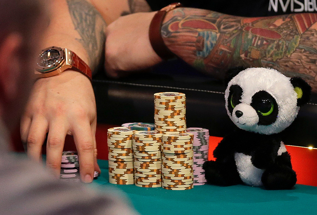 . A panda bear sits next to Jay Farber\'s chips during the World Series of Poker Final Table, Monday, Nov. 4, 2013, in Las Vegas. (AP Photo/Julie Jacobson)