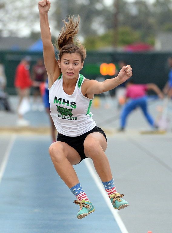 . Monrovia\'s Madison Herrera competes in the Division 3 long jump during the CIF Southern Section track and final Championships at Cerritos College in Norwalk, Calif., on Saturday, May 24, 2014.   (Keith Birmingham/Pasadena Star-News)