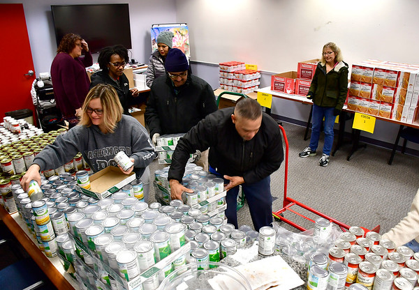 11/15/2018 Mike Orazzi | Staff Bristol Hospital employees sort food for the WIC program at Bristol Hospital provides Thanksgiving meals for 180 low-income families.