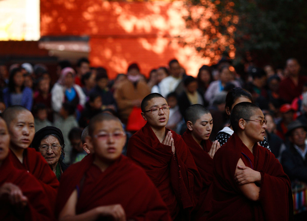 Description of . Tibetan nuns perform a ritual during a function organized at the Tibetan monastery in Boudhanath Stupa to mark the third day of New Year or