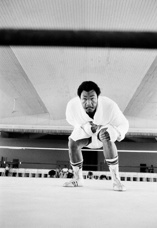 . George Foreman, world heavyweight champion, stands in the ring at his training camp in N?Sele, Zaire, on Monday, Sept. 30, 1974 as he resumed workouts two weeks after he suffered the cut over his right eye that delayed his fight with Muhammad Ali. Foreman shadowboxed for five rounds and exercised with the speedbag. (AP Photo/Horst Faas)