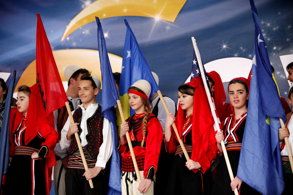 Description of . Kosovo Albanians hold up Kosovar, Albanian and American flags to celebrate the fifth anniversary of Kosovo's declaration of independence in Pristina on February 17, 2013. Kosovo is marking the fifth anniversary of its unilateral declaration of independence from Serbia. An ethnic Albanian-majority province of Serbia, Kosovo proclaimed independence unilaterally on February 17, 2008 in a Western-backed move seen as the final chapter in the bloody breakup of Yugoslavia. ARMEND NIMANI/AFP/Getty Images