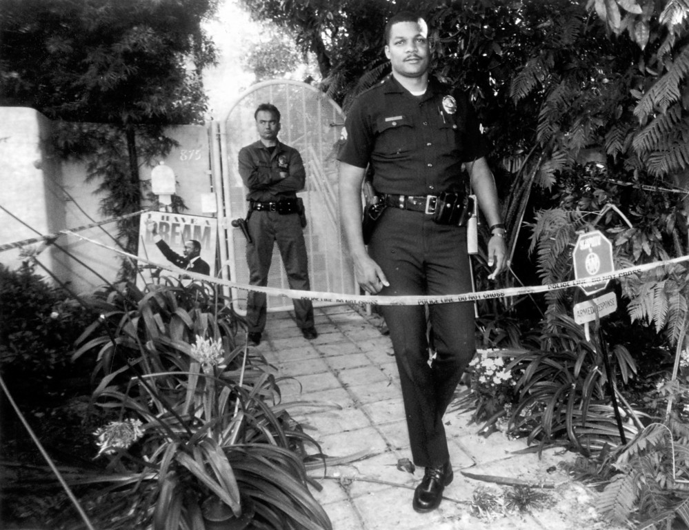 . Police officers stand guard outside Nicole Simpson\'s condo in Brentwood.   (1994)   (Los Angeles Daily News file photo)