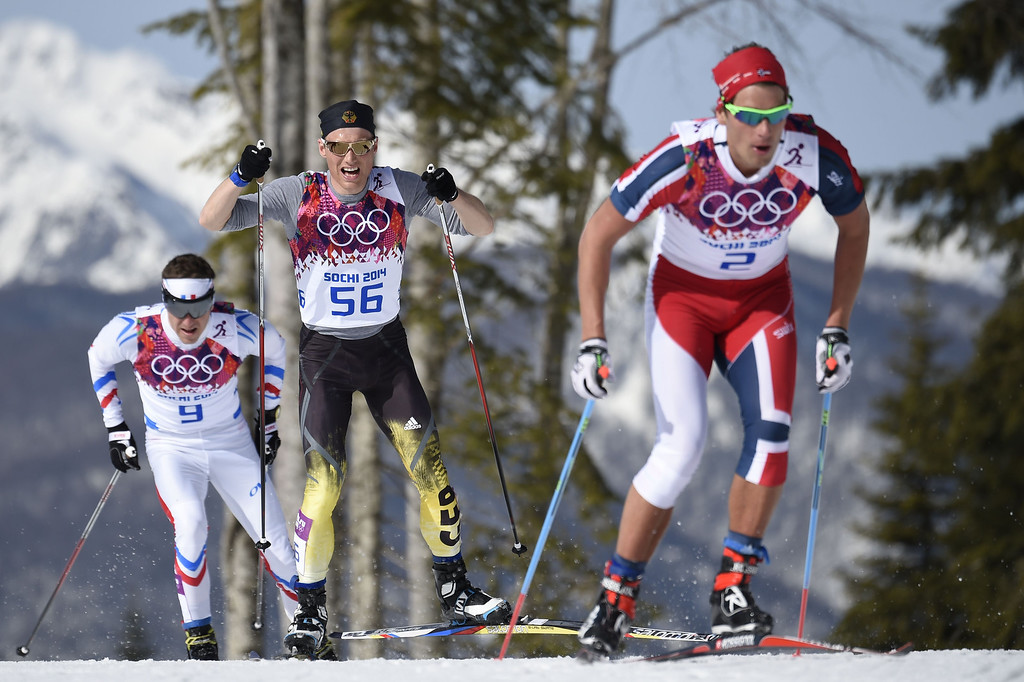 . (From L) France\'s Maurice Manificat, Germany\'s Erik Lesser and Norway\'s Chris Andre Jespersen compete during the Men\'s Cross-Country Skiing 50km Mass Start Free at the Laura Cross-Country Ski and Biathlon Center during the Sochi Winter Olympics on February 23, 2014, in Rosa Khutor, near Sochi. ODD ANDERSEN/AFP/Getty Images
