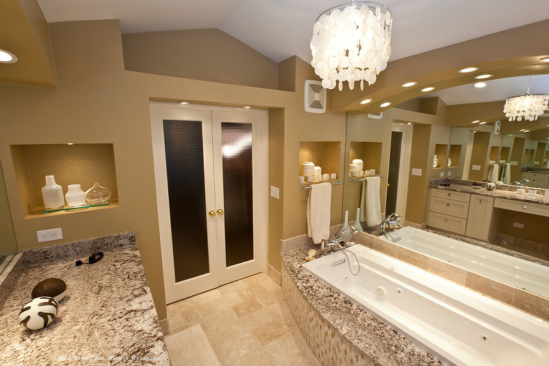 Master Bath's spa-like atmosphere, let in as much or as little light as needed to suit the mood, a perfect way to start, or end, the day.