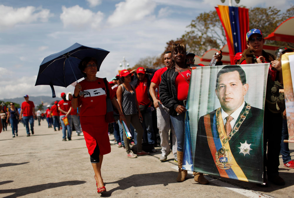 . People line up outside the military academy where the body of Venezuela\'s late President Hugo Chavez is lying in state in Caracas, Venezuela, Thursday, March 7, 2013. While Venezuela remains deeply divided over the country\'s future, the multitudes who reached the president\'s coffin early Thursday were united in grief and admiration for a man many considered a father figure.  (AP Photo/Rodrigo Abd)
