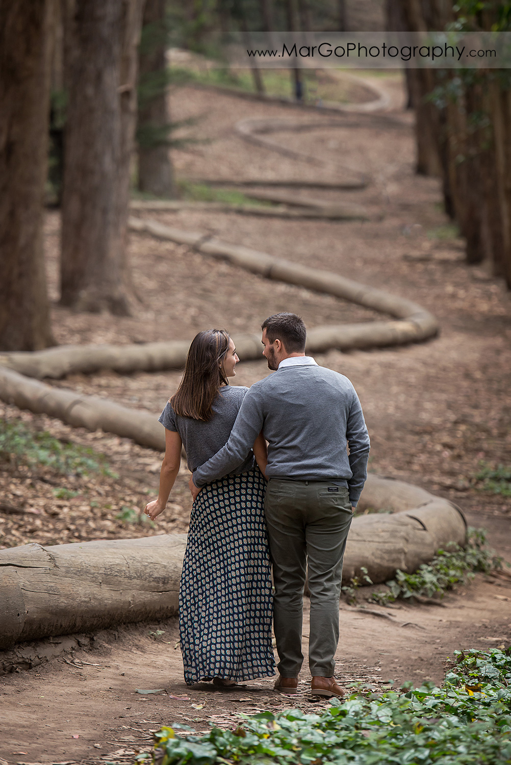eengagement session at Lover's Lane at the Presidio in San Francisco - couple walking way in the park