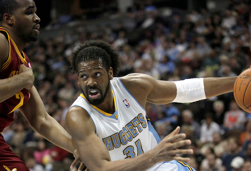 . Best � 5. Nene Hilario* He, too, gets an asterisk because he was drafted by the Knicks with the seventh overall pick in 2002 and was immediately traded to the Nuggets. Nene became a starter for Denver by the end of his rookie season and was named to the All-Rookie First Team in 2003. He averaged 12.7 points and 7. 1 rebounds per game in nine-plus seasons with the Nuggets before being traded to the Wizards in 2012.  Denver Nuggets center Nene Hilario (31)drives around Cleveland Cavaliers power forward Samardo Samuels (24) during the first quarter of an NBA basketball game in Denver, Jan. 15, 2011. Nuggets won 127-99. (AP Photo/Barry Gutierrez)