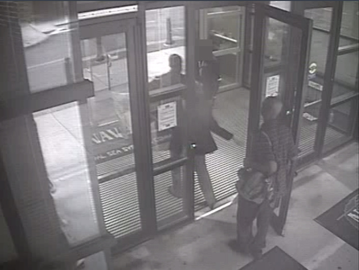 . In this handout frame grab from the Washington Navy Yard provided by the FBI on September 25, 2013, Aaron Alexis enters Building #197 at 8:08 a.m., carrying a backpack September 16, 2013 in Washington, DC. Alexis had legitimate access to the Washington Navy Yard as a result of his work as a contractor, and he utilized a valid pass to gain entry to the building. The FBI investigation indicates that the gunman, Aaron Alexis, acted under the delusion that he was being controlled by extremely low frequency (ELF) electromagnetic waves when he carried out his attack on the Navy Yard, in which 12 people were killed and 4 were wounded.  (Photo by FBI via Getty Images)