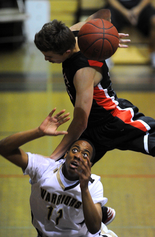 . TORRANCE - 02/15/2013 - (Staff Photo: Scott Varley/LANG) In a CIF Southern Section Division III-AAA second-round boys basketball matchup, West beat Hart 64-55. West\'s Christian Jackson is fouled over the back by Andrew MacArthur.