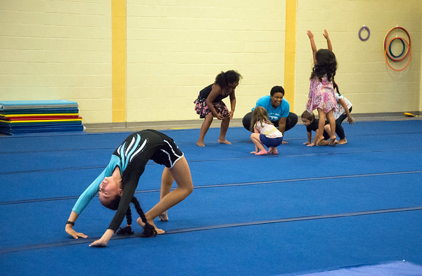 08/22/19 Wesley Bunnell | Staff The New Britain YWCA held an open house on Thursday August 22, 2019 to showcase the programs and benefits for prospective members by having them visit scavenger hunt stations each with a different theme. YWCA gymnastics team member Makaila Matos, L, practices as prospective members work with an instructor off to the side.