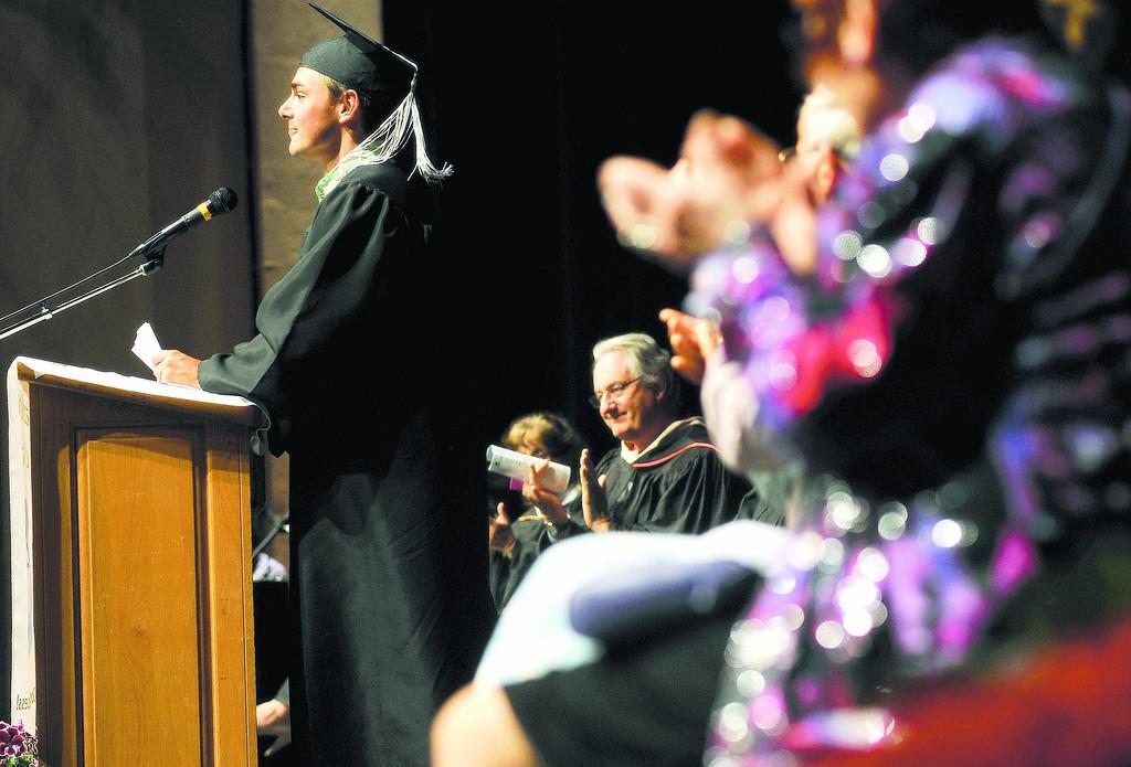. Watsonville/Aptos Adult Education graduate, Matt Haimes, makes his final remarks during his commencement speech Thursday evening at the Mello Center in Watsonville. (Matthew Hintz/Sentinel)