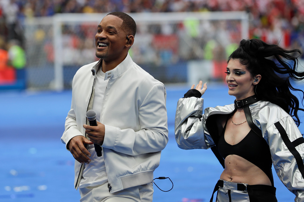 . Singers Will Smith, left, and Era Istrefi, right, perform during the closing ceremony prior to the final match between France and Croatia at the 2018 soccer World Cup in the Luzhniki Stadium in Moscow, Russia, Sunday, July 15, 2018. (AP Photo/Matthias Schrader)