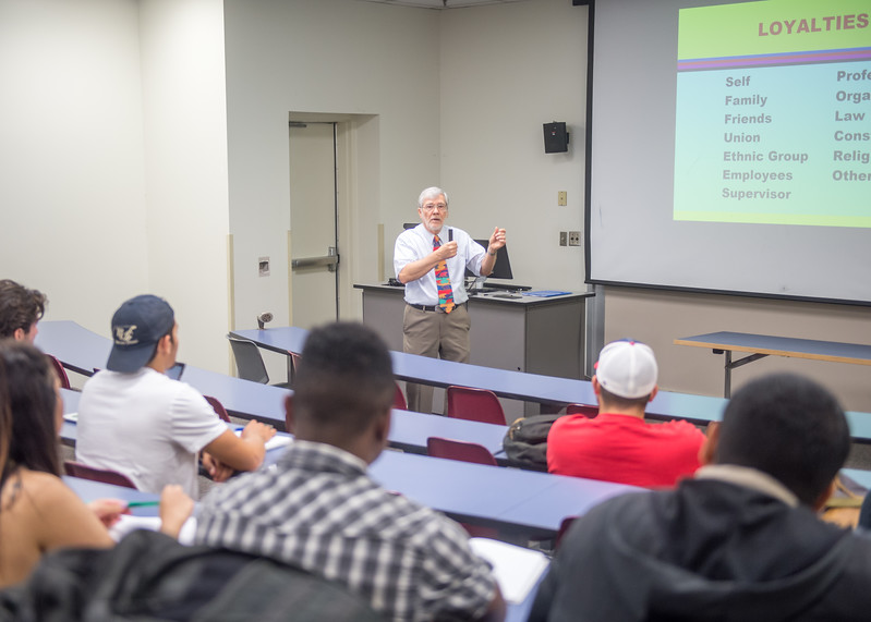 Dr. Philip Rhoades, Professor in the College of Liberal Arts, speaks to his class about the different kinds of loyalties during his Police Supervision and Management course.