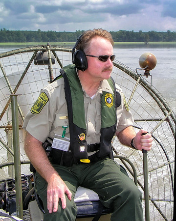 Running an airboat when I was a game warden. (photo by Tom Bidrowski 8/2008)
