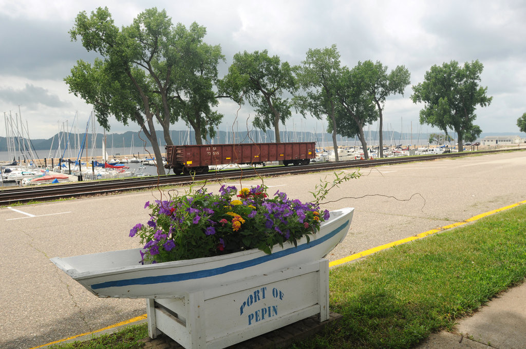 . The town of Pepin is filled with nostalgia, including boats filled wtih flowers across from the harbor on July 26, 2013. (Pioneer Press: Ginger Pinson)