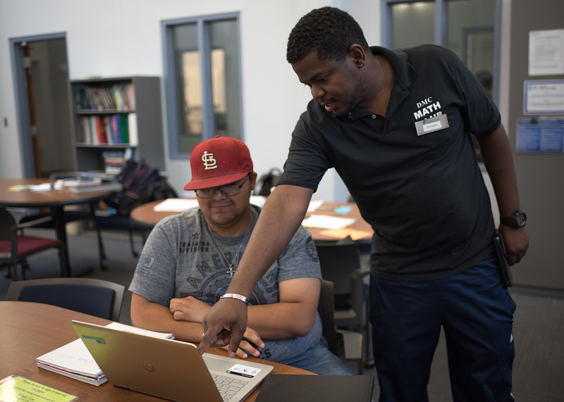 Center for Academic Student Achievement (CASA) tutor Stephen Henry helps Trevor Sontag with his calculus homework.   For more information about CASA's services: http://bit.ly/1hswXLM