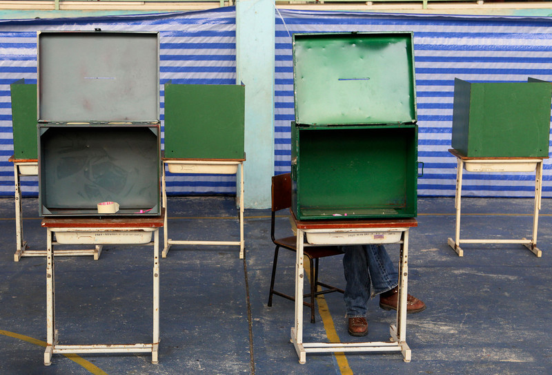 . Empty ballot boxes are shown before the voting for the general election at a polling station in Bangkok, Thailand, Sunday, Feb. 2, 2014. Thailand\'s tense national election got underway Sunday amid signs of disruptions at several polling stations and fears of violence, a day after gun battles between protesters and would-be voters broke out at a busy Bangkok intersection. (AP Photo/Sakchai Lalit)
