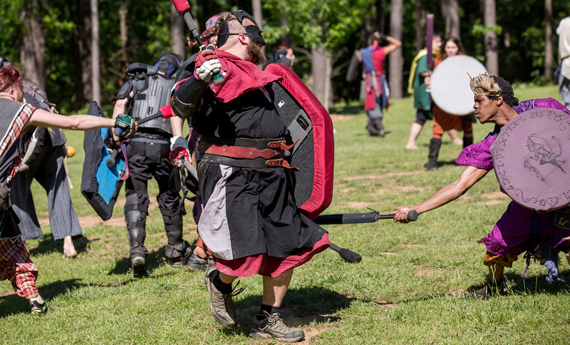 Yose of the Cu Sith aka Joseph Shores of Monroe, left, looses a leg at the hand of Ronnie Hardeman, right, of Decatur, known as Vayne at the games. The local High Spires chapter practices on weekends in Blackburn Park.  The live action game is a full-contact combat game that uses foam padded boffer weaponry. The High Spires is an official Dagorhir Battle Games chapter, focusing their efforts on veterans and new members.  (Jenni Girtman / Atlanta Event Photography)