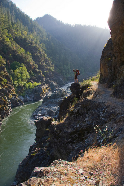 The Rogue River Trail hugs the sheer cliff walls above Stair Creek Falls at Inspiration Point.