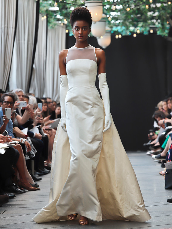 . The first-ever bridal gown from the late fashion designer Amsale Aberra - created in 1990, is modeled after the unveiling of the latest collection from Amsale, during Bridal Fashion Week, Friday, April 13, 2018, in New York. (AP Photo/Bebeto Matthews)