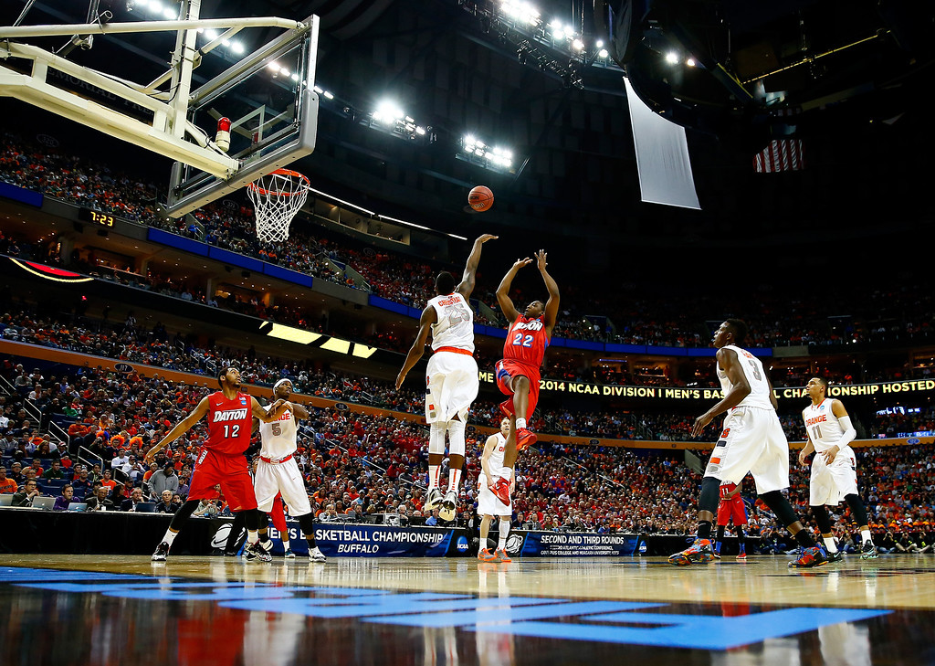 . BUFFALO, NY - MARCH 22: Kendall Pollard #22 of the Dayton Flyers takes a shot as Rakeem Christmas #25 of the Syracuse Orange defends during the third round of the 2014 NCAA Men\'s Basketball Tournament at the First Niagara Center on March 22, 2014 in Buffalo, New York.  (Photo by Jared Wickerham/Getty Images)