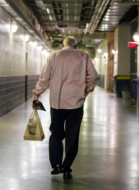 . Charlie Manuel walks out of the stadium after being fired as manager of the Philadelphia Phillies before a baseball game against the Los Angeles Dodgers, Friday, Aug. 16, 2013, in Philadelphia. Manuel, the winningest manager in franchise history, was replaced by Hall-of-Famer and former Chicago Cubs second baseman Ryne Sandberg, the Phillies\' third-base coach. Sandberg takes over beginning with Friday night\'s game against the NL West-leading Dodgers. (AP Photo/Chris Szagola)