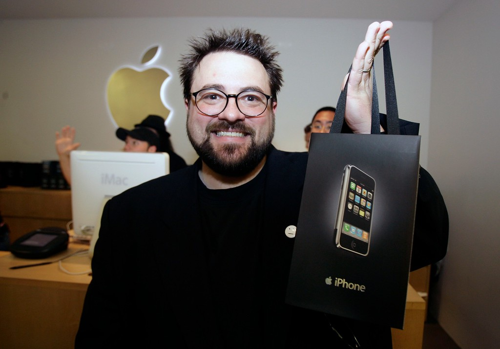 . Screenwriter and director Kevin Smith smiles after purchasing two iPhones, Friday, June 29, 2007, at the Apple store at The Grove shopping center in Los Angeles. (AP Photo/Damian Dovarganes)